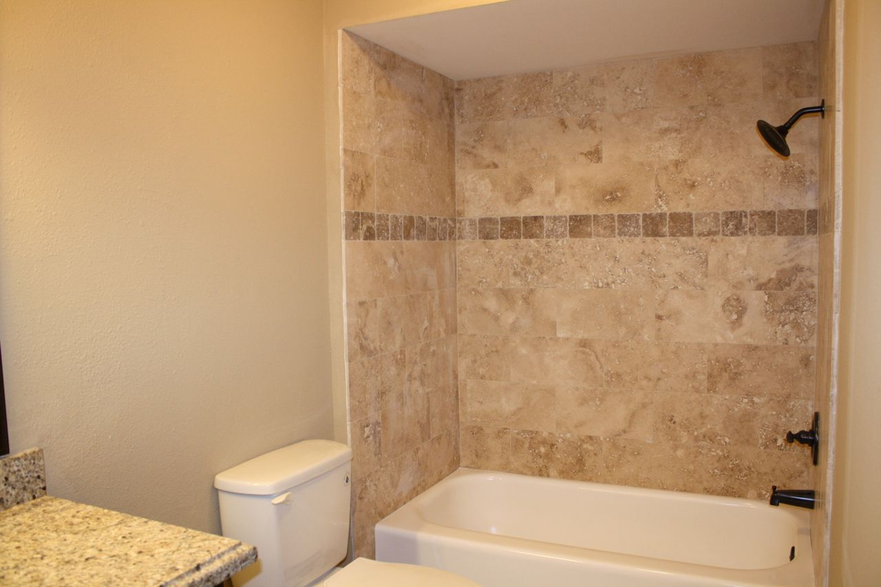neutral colored shower wall tile with nice, neutral accent ...