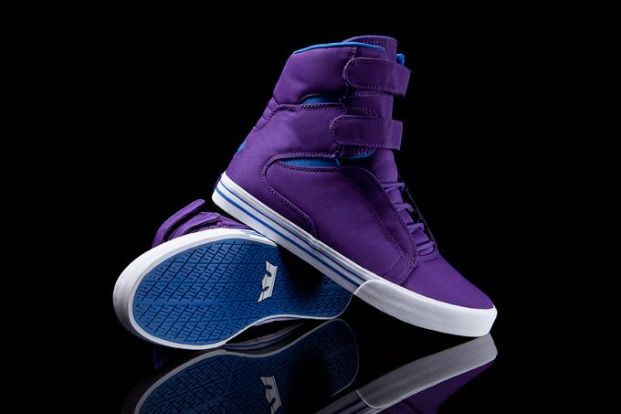 The Society, with its distinctive Velcro straps, is the tallest high top in the SUPRA catalog and this style is outfitted with a purple nylon upper and royal accents