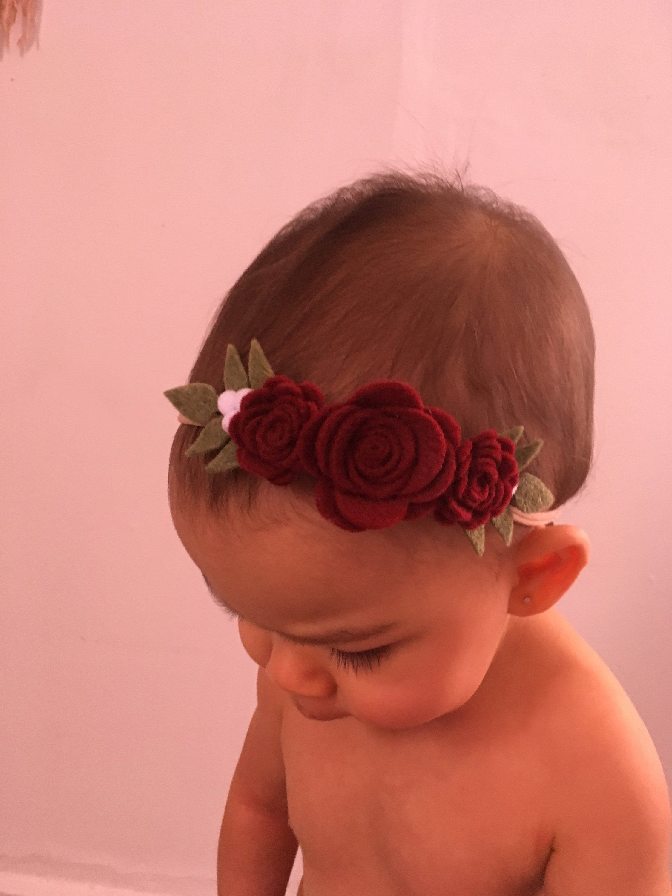 Garnet Red Rose Felt Flower Baby Headband Christmas, Baby Girl Headband, Girl Flower, Baby Headband, Flower Headband, Felt Flower Headband #babygirlheadbands Beautiful Felt Flower Crown Headband for your Baby Girl first portrait, birthday picture, special occasion, wedding or family pictures. Stunning garnet red garland headband. -Color Garnet Red, olive green, white felt balls.  -Size The flower crown measures from flower to leaves 5 long x 2 inches wide. -Finish/ Band  Nude Nylon Headband. I #feltflowerheadbands