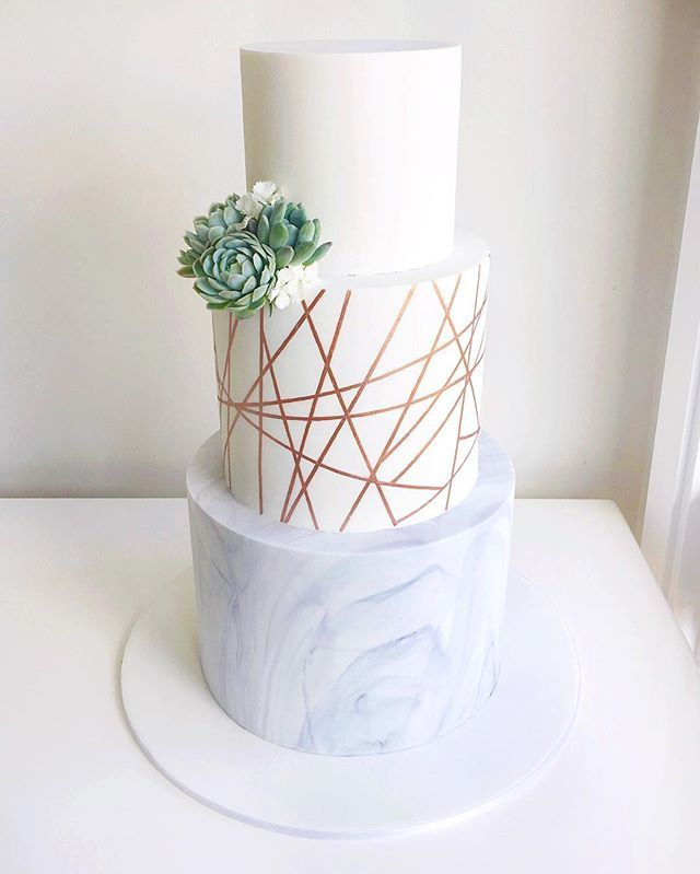 A very modern wedding cake composed of marble, geometric rose gold and succulents for Kristy and George Succulents courtesy of @verdaflore