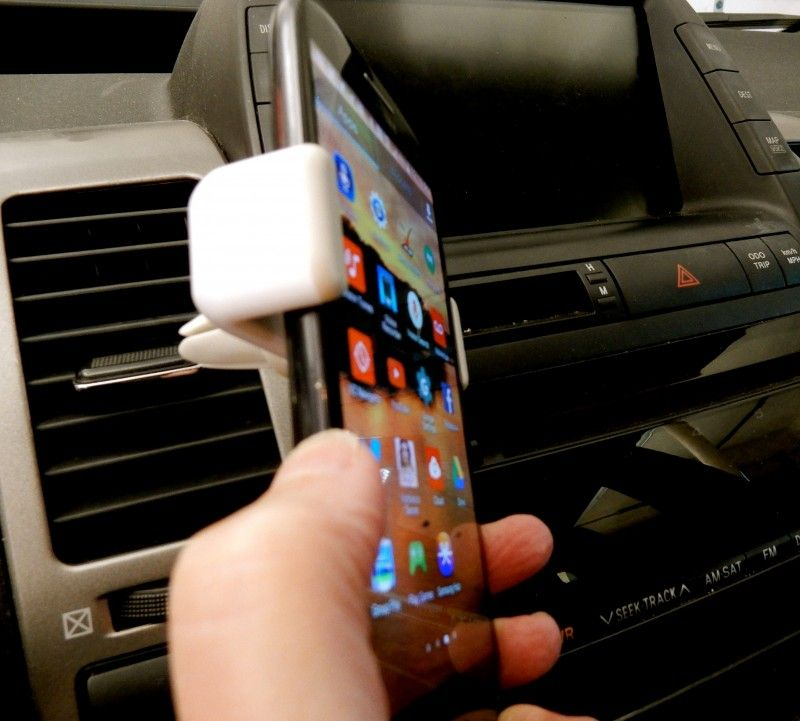 Airframe Portable Car Mount. This device solves the problem of having to balance your mobile phone on your lap to read GPS directions. The Airframe grips the phone and locks it into the car's air vent – at the optimal angle for viewing – and releases easily. A must for road-trippers of all ages.