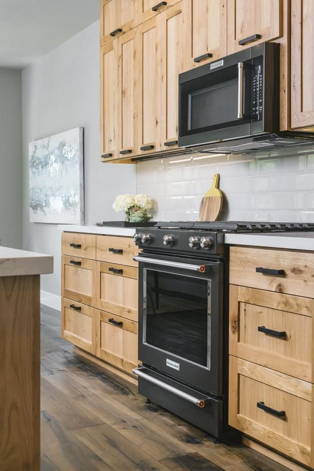Hgtv Presents Contemporary Kitchen With Black Gas Range And Over The Range Microwave Includes Natural W Wood Kitchen Cabinets Light Wood Cabinets Wood Kitchen