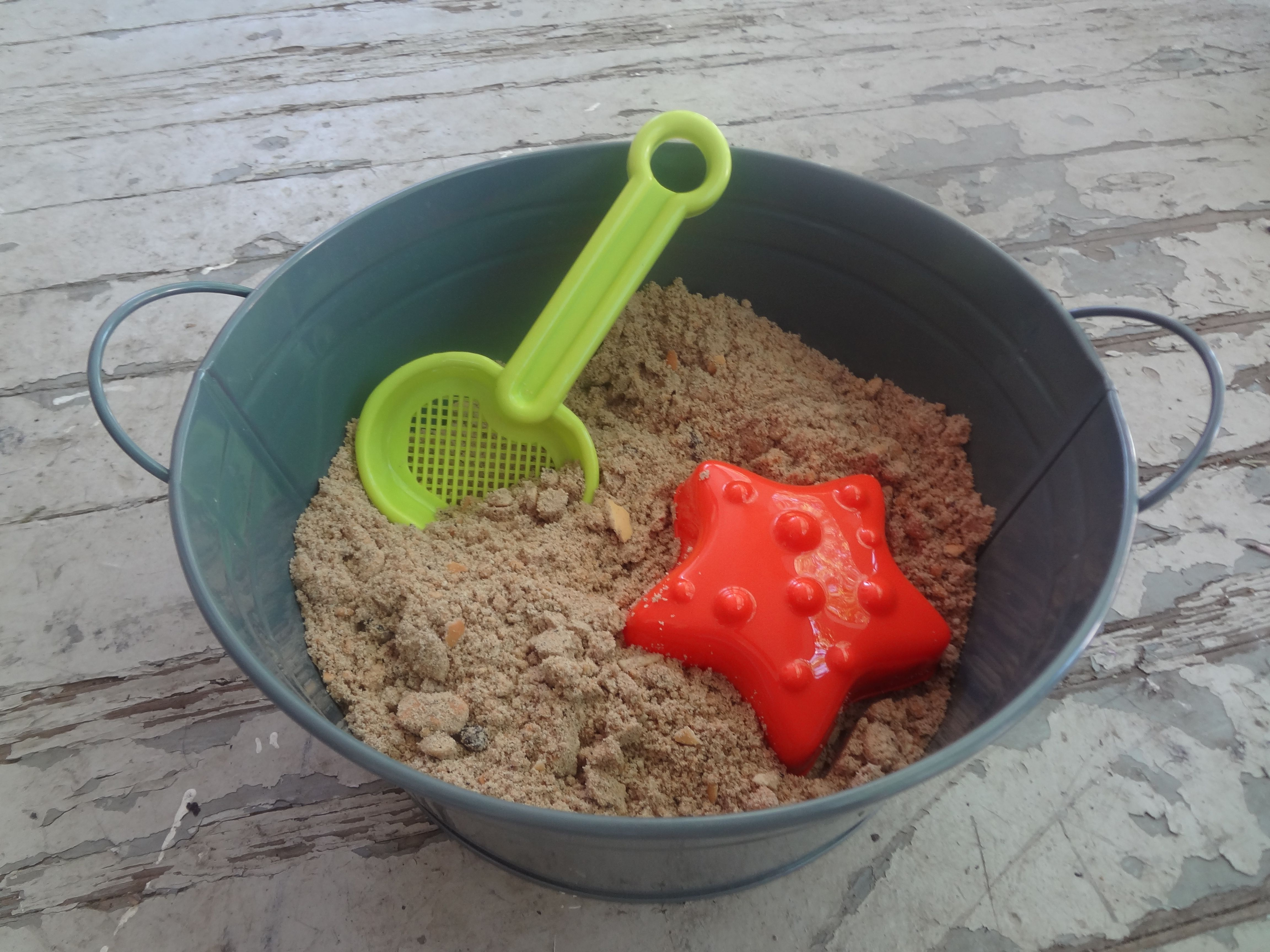 Edible Sandbox.  Made with crushed up cookies so if the kiddos eat it...who cares!