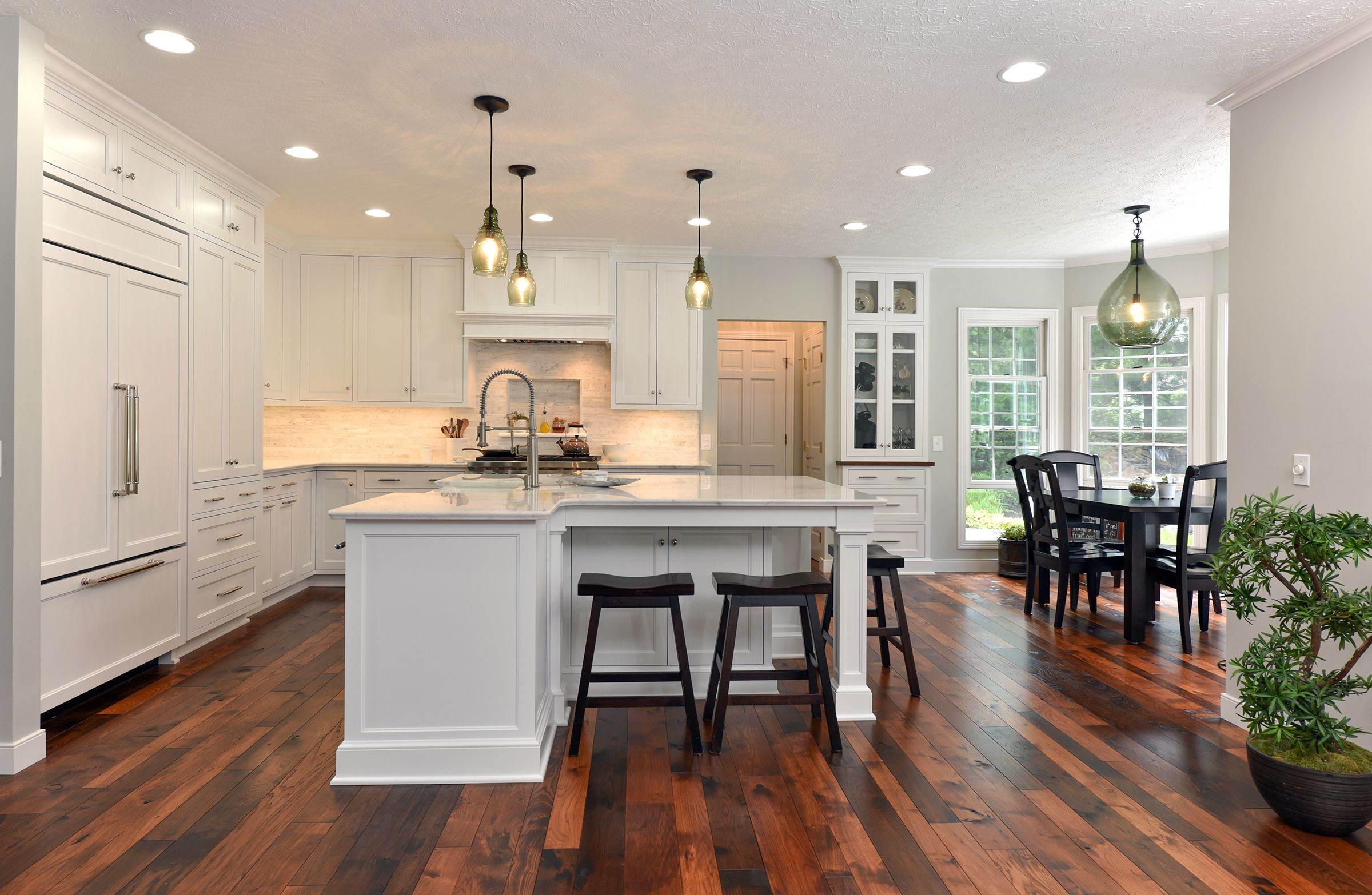 This transitional style kitchen features Quartzite ...