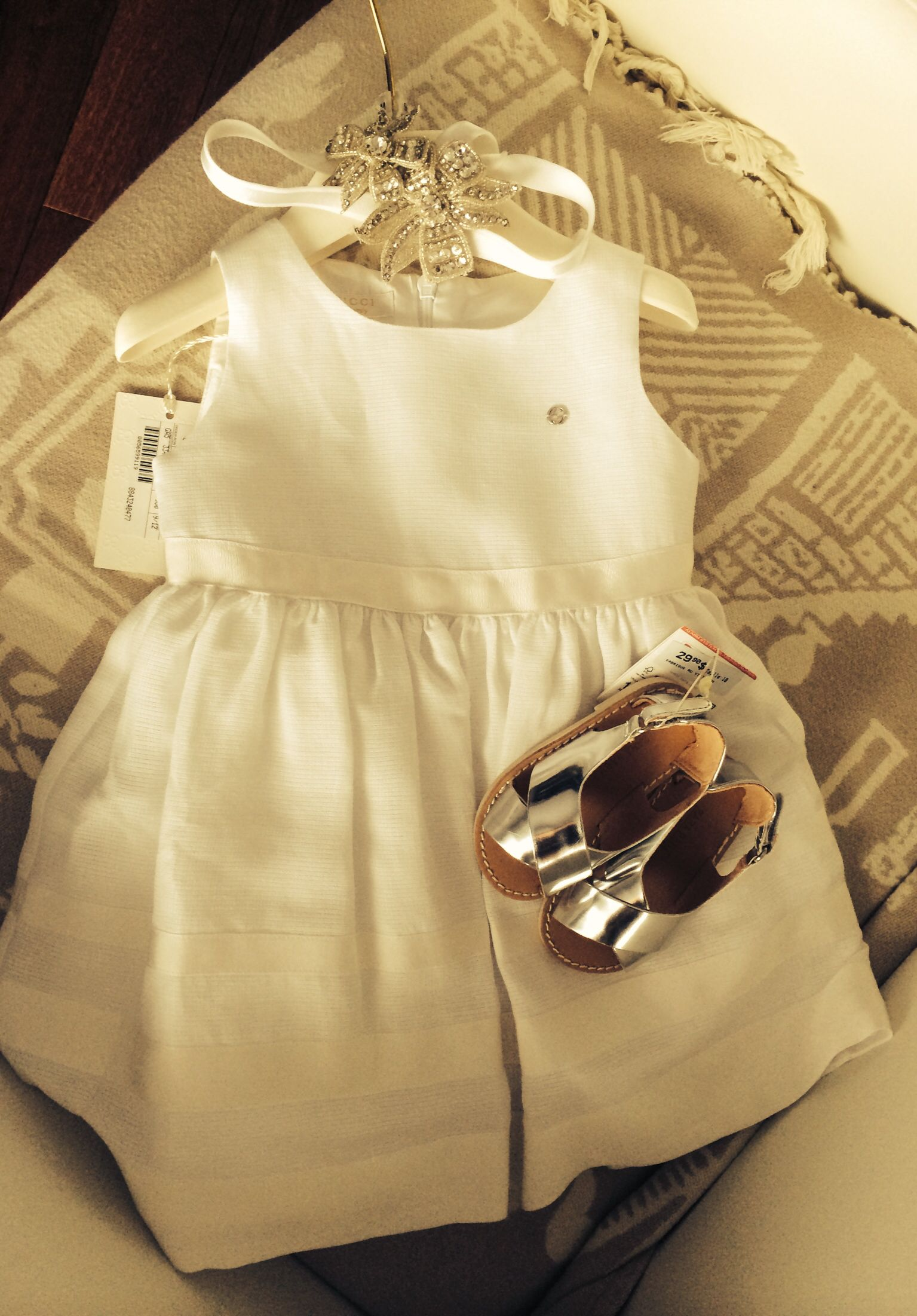 520af6bd6 Baby girl baptism outfit: Gucci white teared dress, Zara chrome sandals and  a headband with rhinestones (part of the headpiece worn by her mother when  she ...