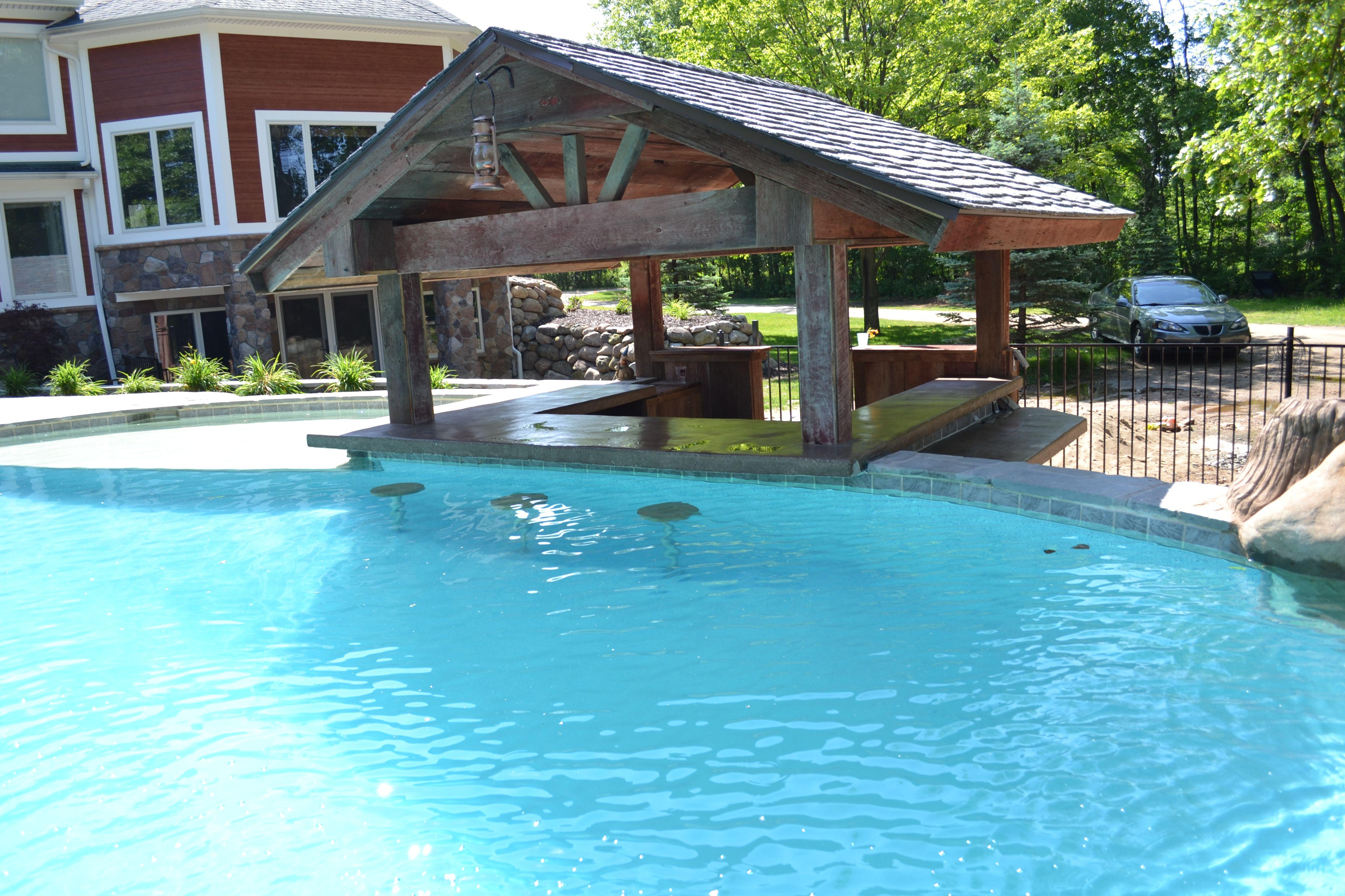 Hybrid pool hof in brighton mi legendary escapes for Pool design with swim up bar
