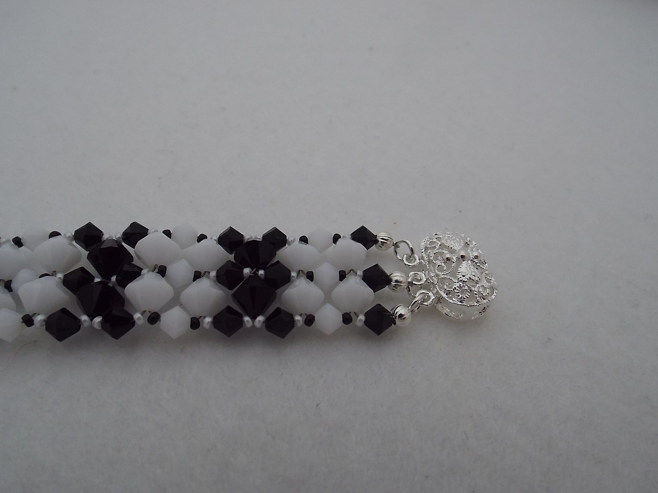 Black and White striped multi strand bracelet made with Swarovski Crystals.  Click on picture to check out my store. Thank You.