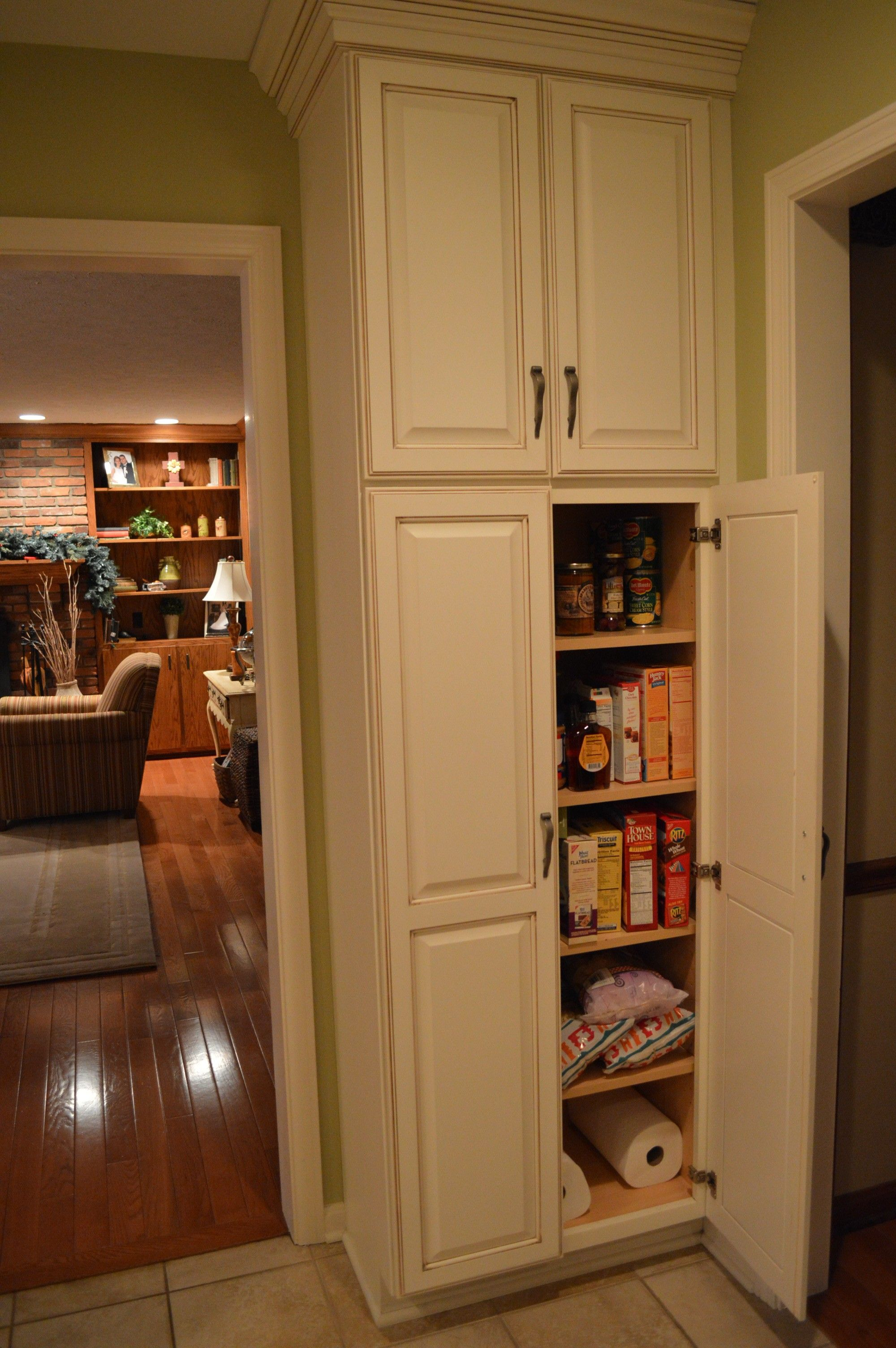 F White Wooden Tall Narrow Pantry Cabinet With Maple Wood Shelves And Door Panel