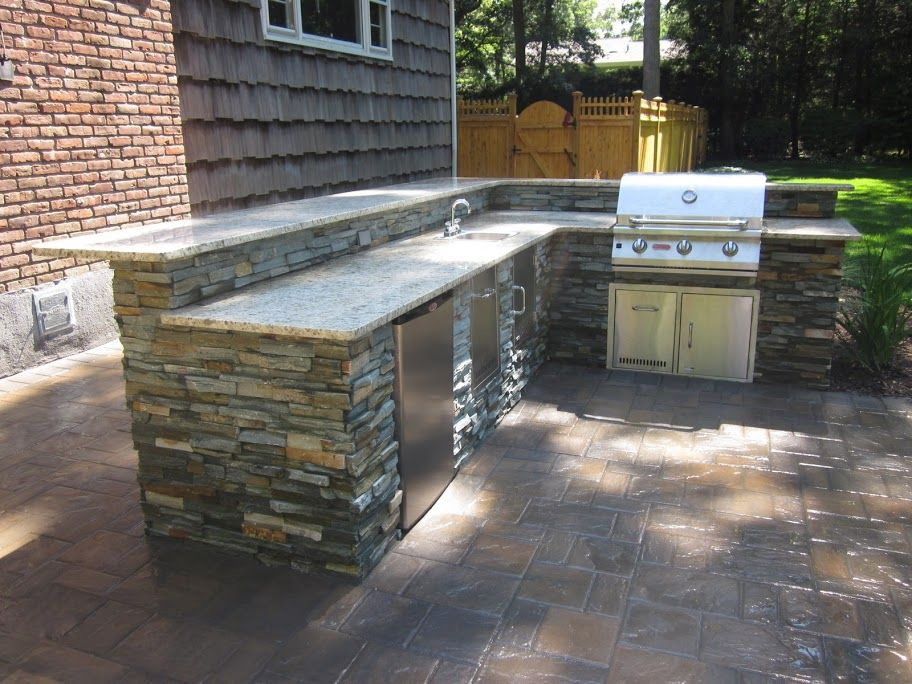 Outdoor Kitchen With Raised Bar Veneered With East West Stone