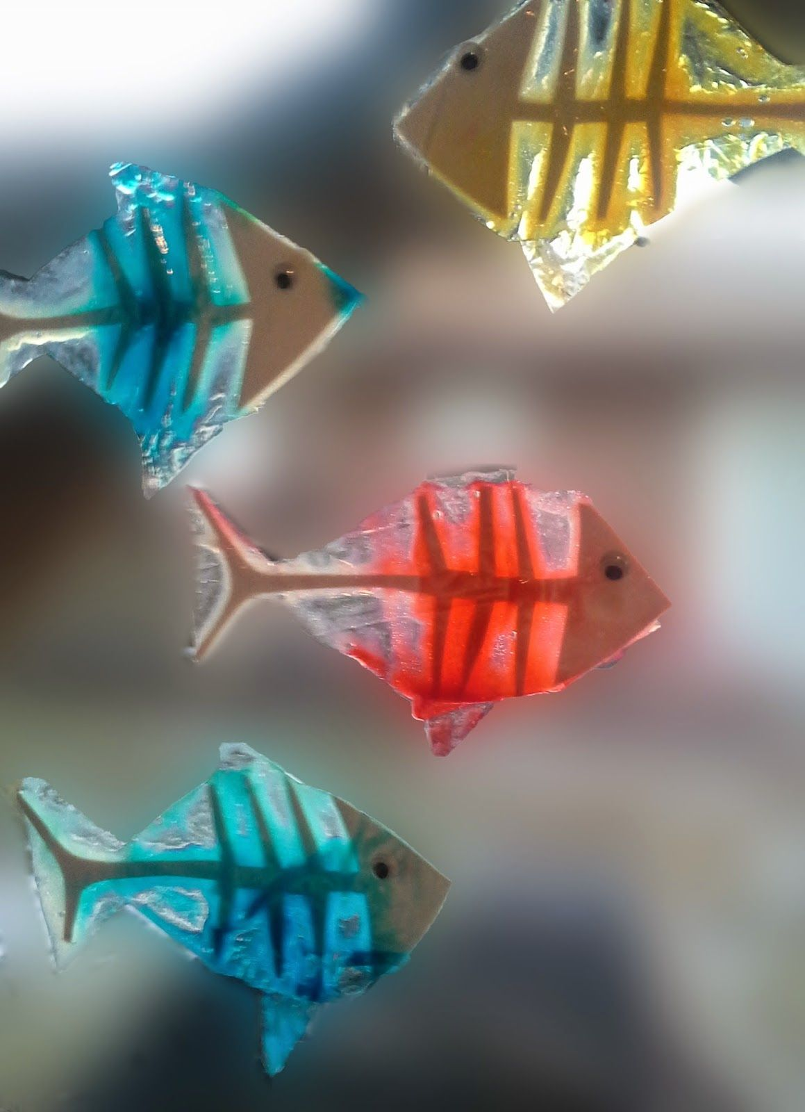 our X-ray fish that we made last time using glue and food dye to ...