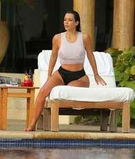 Kim Kardashian on honeymoon in Mexico wet see through beater tank top shirt