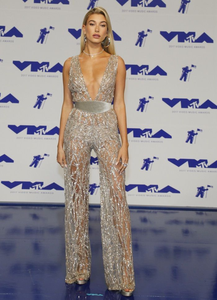 8d030ea4c8 Hailey Baldwin in a silver sheer Zuhair Murad jumpsuit and Jimmy Choo