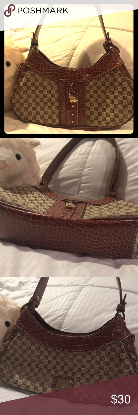 """Liz Claiborne locked monogrammed Bag never used This is such a nice bag and it somehow hid away in my closet...therefore it's never been used! Monogrammed canvas, polished brass hardware & 3 separate pocket sections. Very nice small bag!! 12"""" long x 6"""" wide and the strap drop is 10"""" Liz Claiborne Bags Mini Bags"""