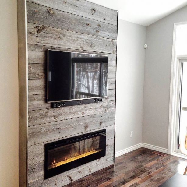 Nice fireplace feature wall done using our classic grey reclaimed barn board. We really like the metal edging used to complete the modern look. What do you think of this one? #fireplace #featurewall #barnboard #barnwood #barn #reclaimed #reclaimedwood #rustic #rusticwood #igers #toronto #hamilton #hamont #tdot #the6ix #905 #lumber #loft #condo #GTA #woodworking #diningtable #ontariowood #liveedgeslabs #maker #customfurniture #woodworking
