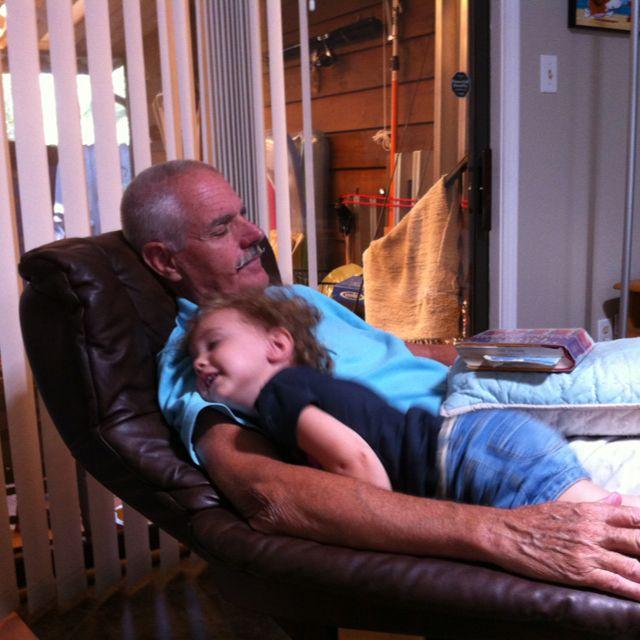 Tessa pretending to take a nap with Uncle Wayne.