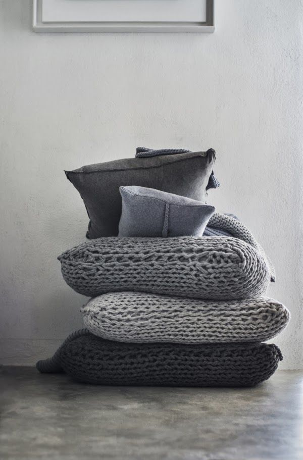 Cozy chunky sweater knits covering big comfy floor cushions ...