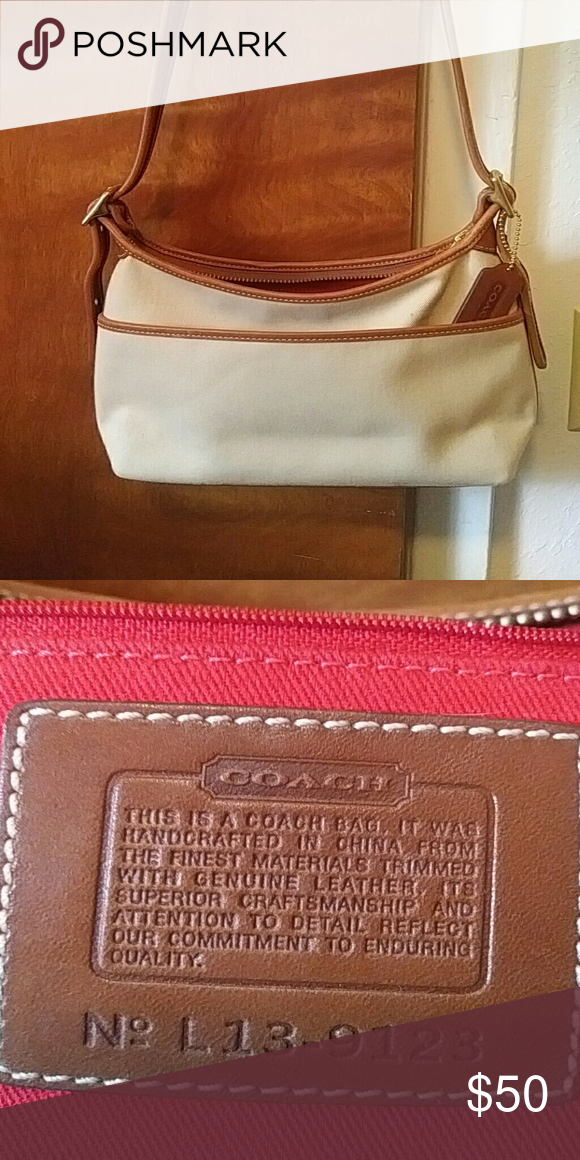 a02417d160 Coach purse Khaki canvas with brown leather trim and over the shoulder  strap. Red interior canvas. Small purse. Coach. Coach Bags Shoulder Bags
