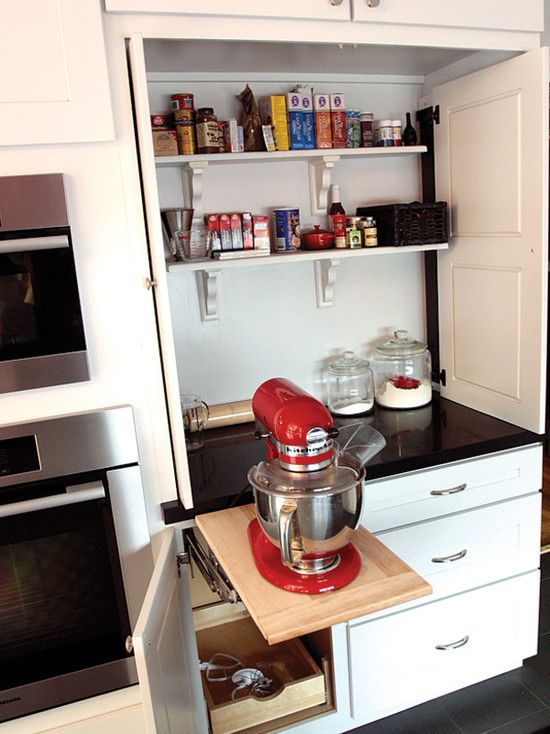 A Pink Kitchenaid Mixer Sits Atop A Pop Up Shelf Fixed Beneath A