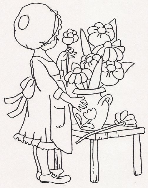 Girl Putting Flowers in Vase by jeninemd, via Flickr