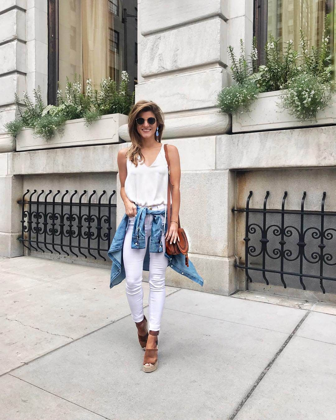 2f7503e39a all white outfit with denim shirt around the waist