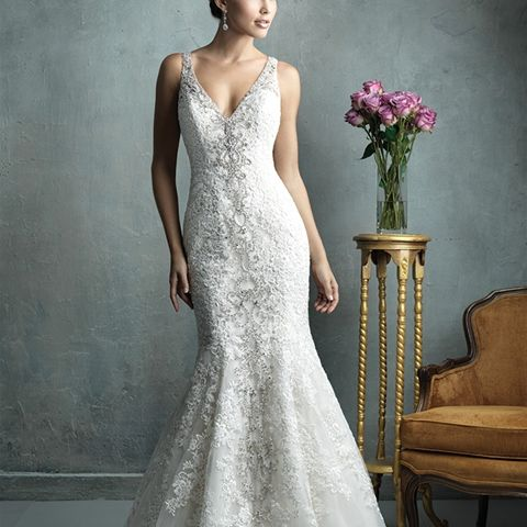 C322 - Why choose lace, beading, tulle or embroidery when this slightly flared, slim-fitting gown gives you the best of all of them?