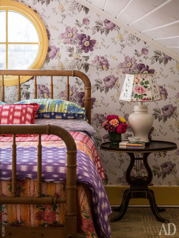Charming attic bedroom where shabby chic meets Artsy Bohemian.  Old-fashioned floral wallpaper blends