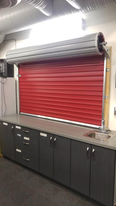 Using A Roll Up Door As Kitchen Divider Rollupdoor Commercial Garage Doors Roll Up Doors Doors