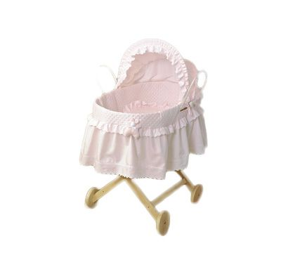 £170.00 Beautiful moses basket with quilted interior and bunny detail.  Complete with drapes, BS mattress, quilt and little pillowcase. Solid bottom to palm basket and handles go all the way underneath. Internal dimensions = 77cm x 37cm