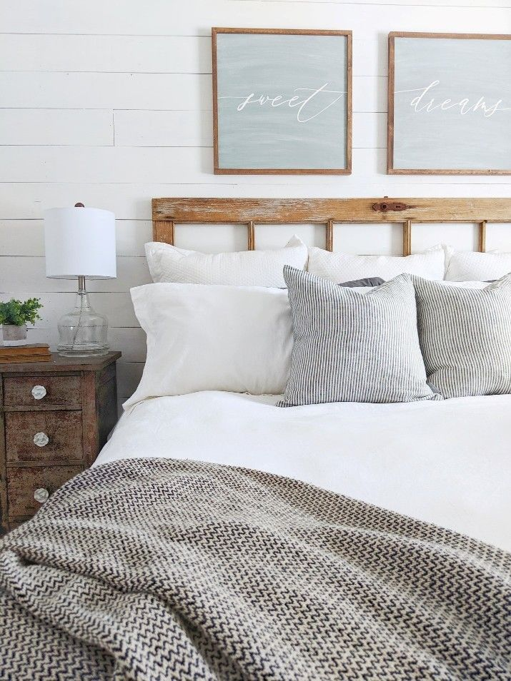 Style your bedroom with gorgeous pillows, cozy blankets, and beautiful table lamps to create the perfect modern farmhouse bedroom! Thanks for the inspiration, Our Forever Farmhouse! #modernfarmhousebedroom