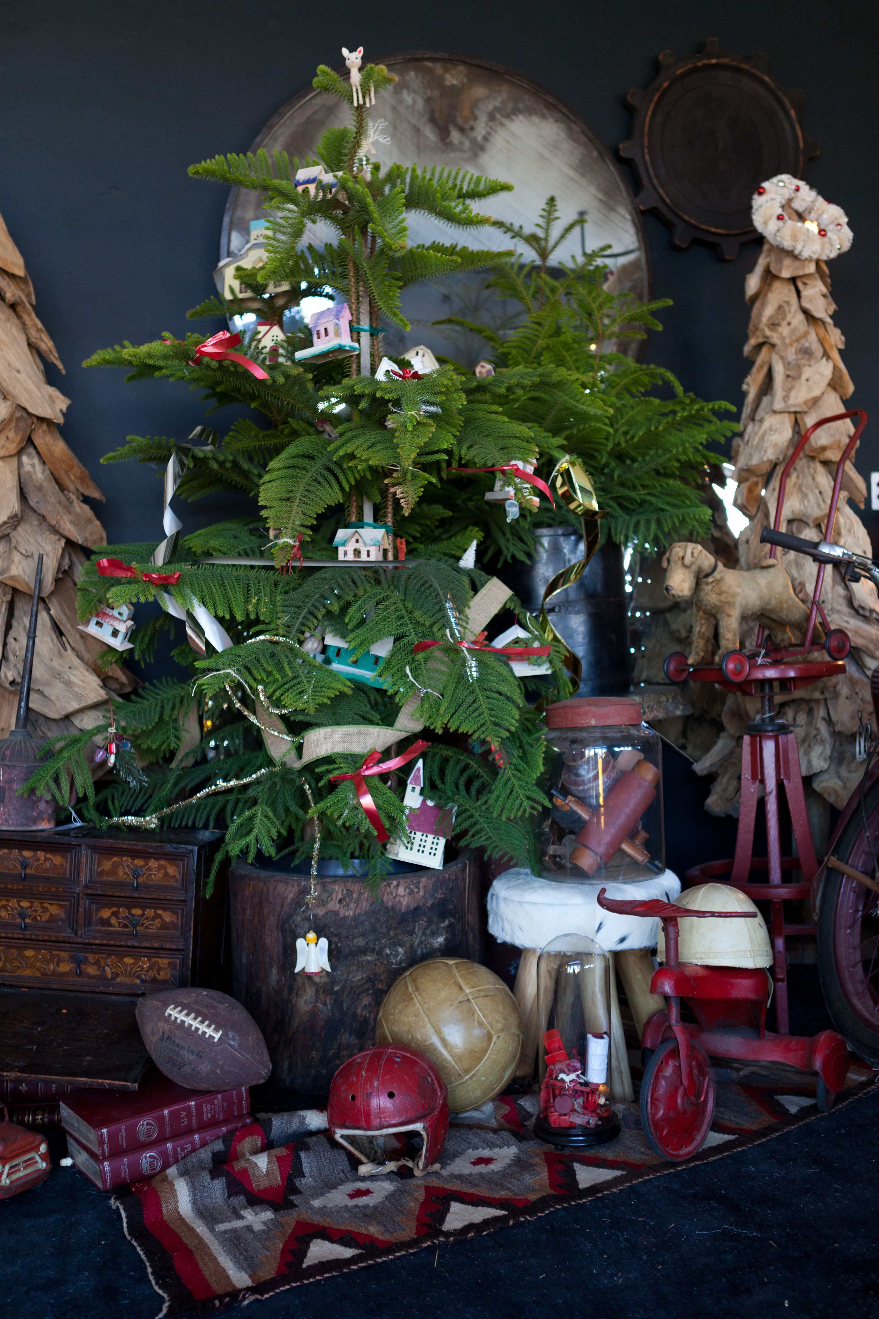 Decked for the holiday in organic Christmas cheer. Evergreen, antiques and one-of-a-kind gifts under the tree. http://www.bdantiques.com/