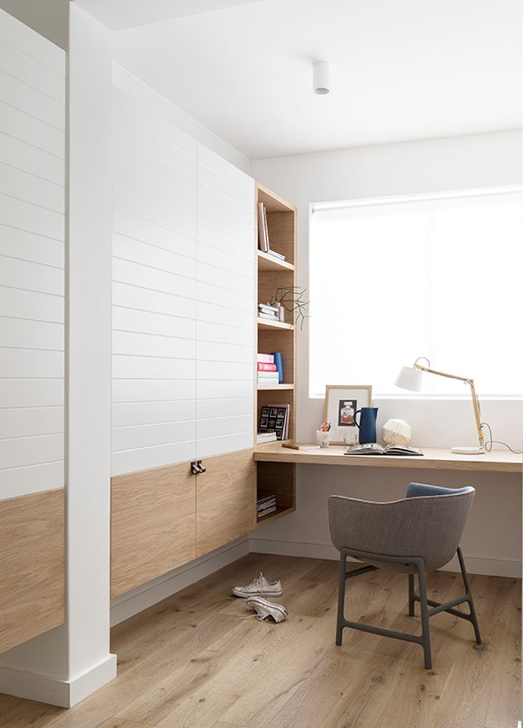 home office desk integrated into shelving and wardrobe units. Blonde wood and white with grey chair & home office desk integrated into shelving and wardrobe units. Blonde ...