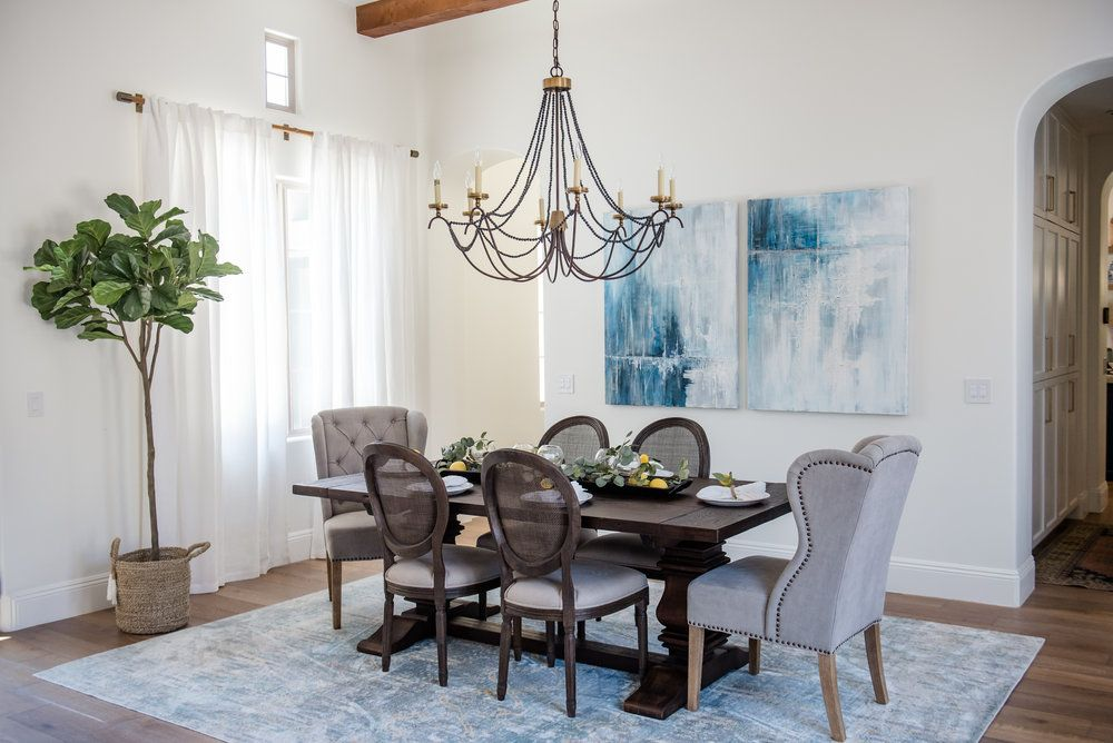 Dining Room with blue accents throughout, with a hint of ...