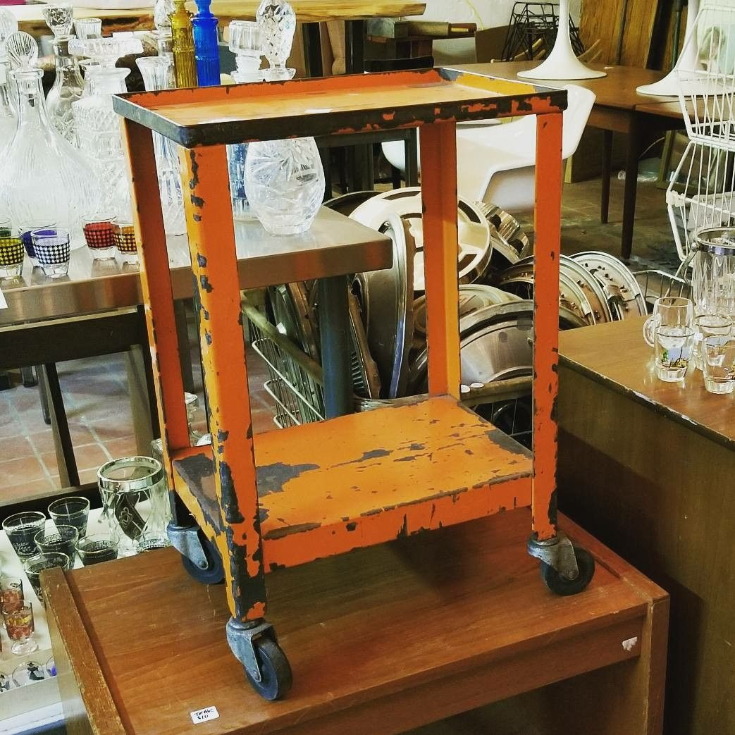 industrial vintage miniature orange trolley or cart in london