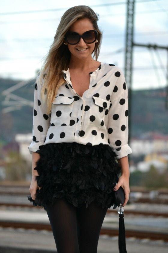 black on white dotty & feathery skirt, black stockings.  LOVE!