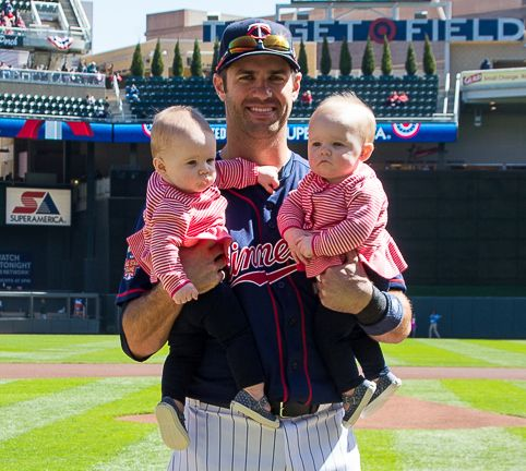 5863b962ec8 Proud father Joe Mauer with his twin girls. Minnesota Twins Baseball ...