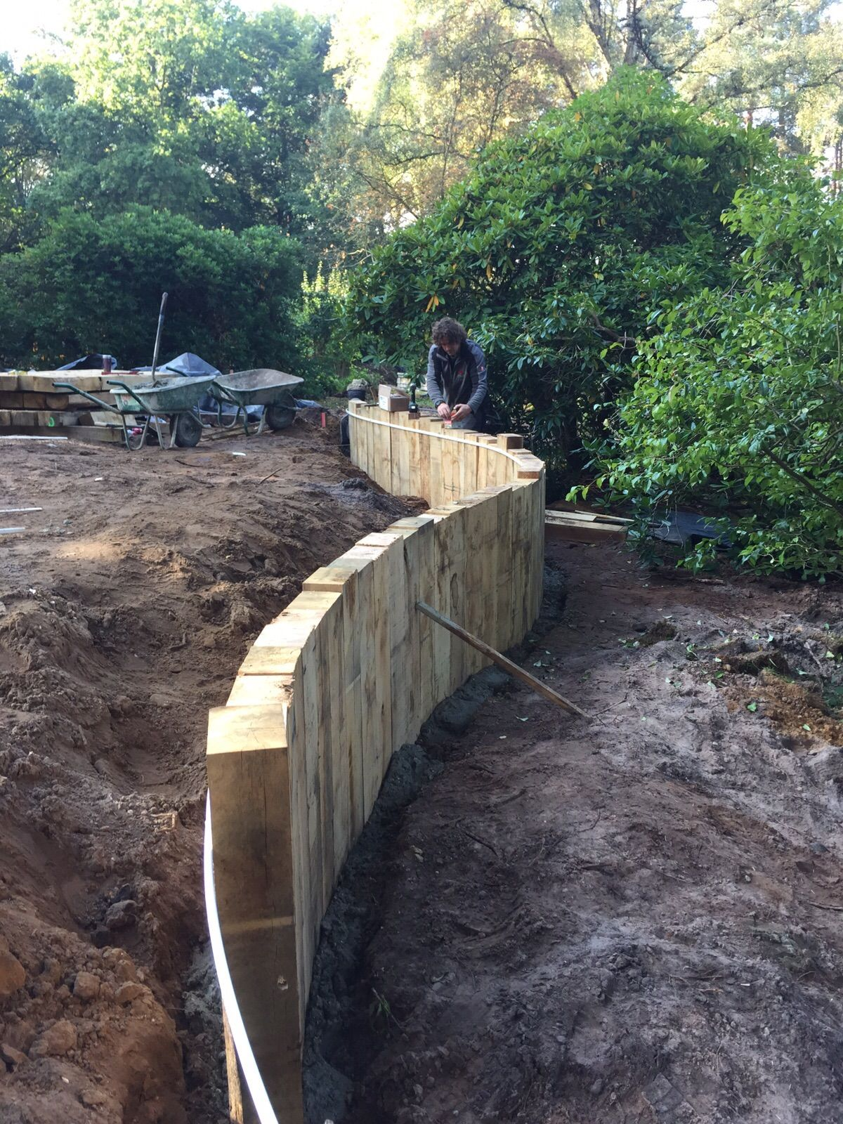 Garden Design Using Sleepers curved timber retaining wall with vertical railway sleepers