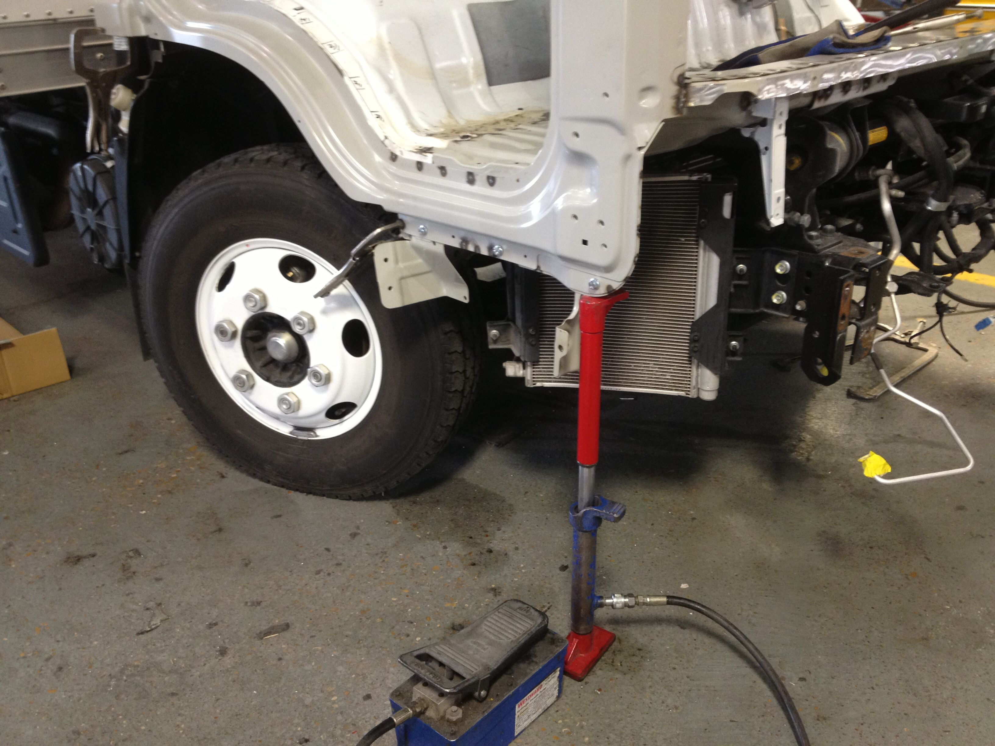 Collision Damage Repair On An Isuzu Npr In This Picture The Door Frame Is Being Squared And Spot Welded In Place Spot Welding Roll Up Doors Repair