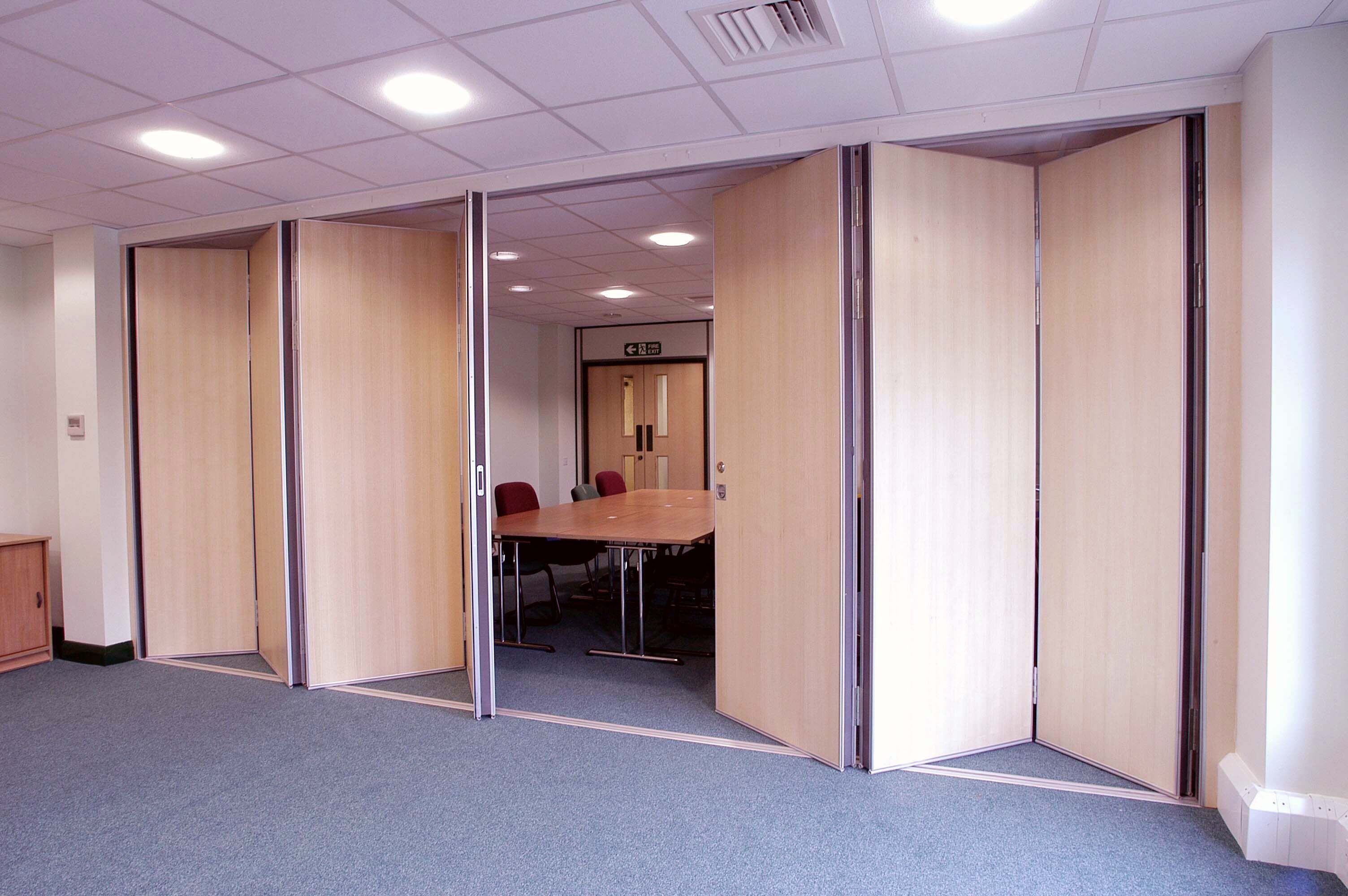 Frosted Glass Room Divider With Two Panels Connected By Beige Wall