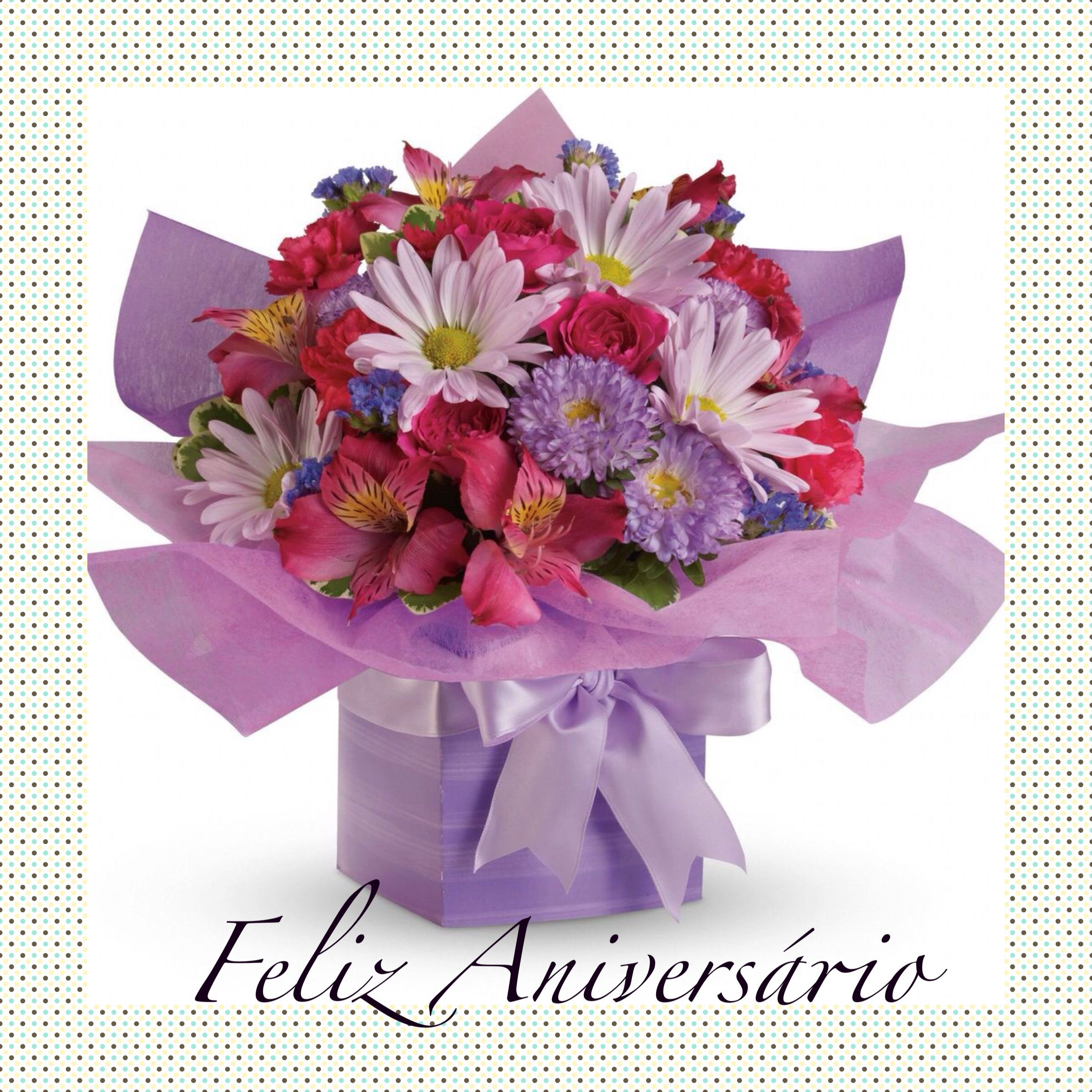 Feliz aniversrio gardening pinterest flower arrangements this pretty purple present comes with a beautiful surprise a lovely bouquet of flowers thats perfectly arranged and wrapped to look like a present izmirmasajfo