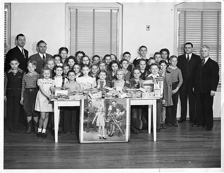 A class in Hattiesburg, MS, poses with donations they collected for the March of Dimes in the 1930's.