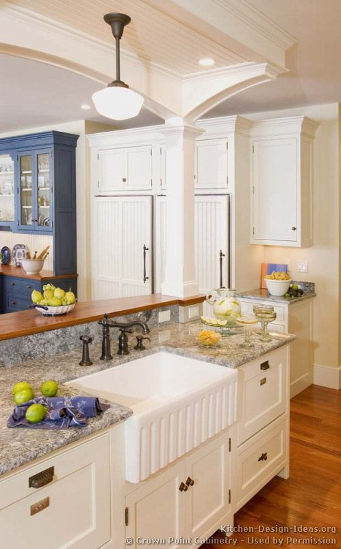 Kitchen Idea of the Day: This luxury kitchen island includes an apron sink flanked on both