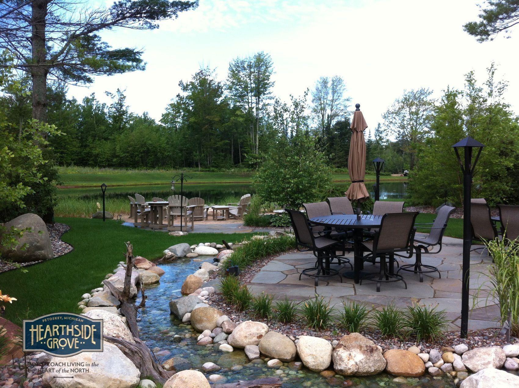 Hearthside Grove Luxury Motorcoach Resort Lot 135   #exterior #patio #stone  #creek