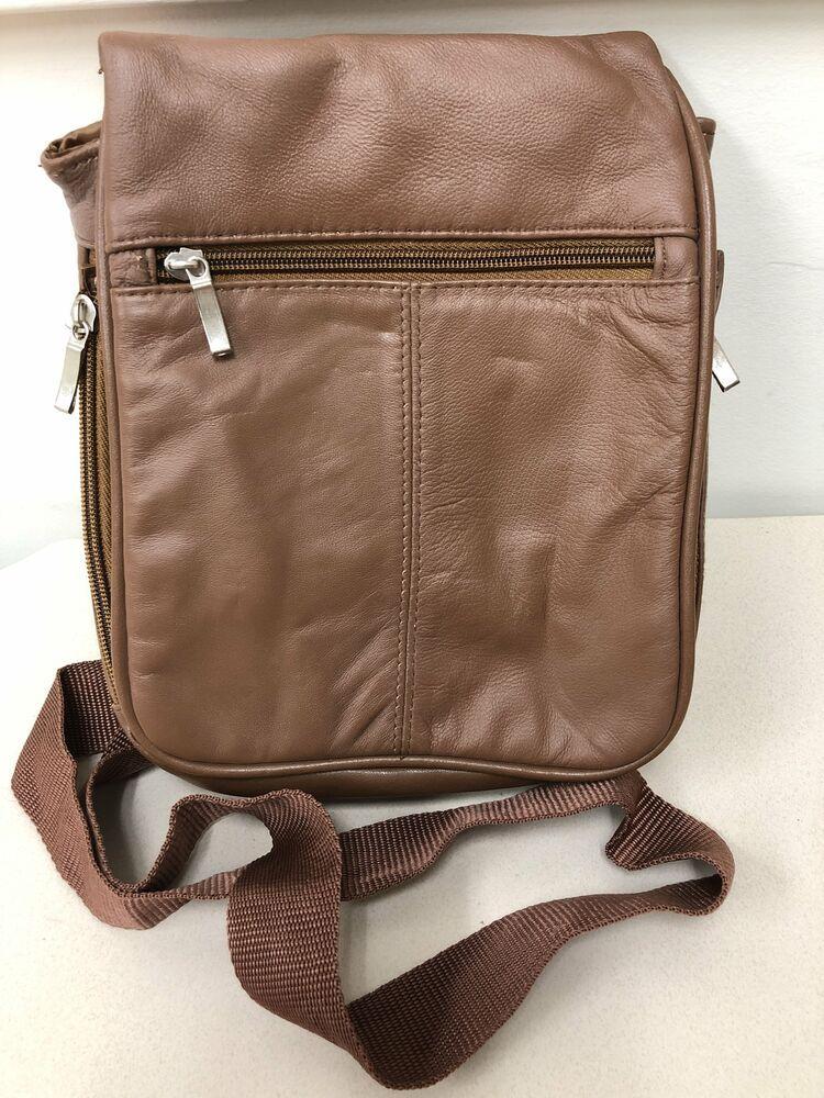 A Travel Hand Shoulder Work Unisex Bag With 4 Zip Pockets Flap Over.