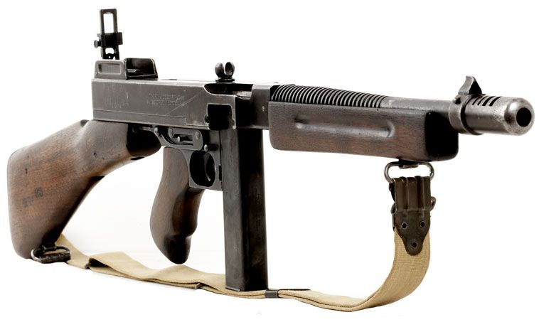 Check out this M1 Tommy, see the Lyman rear sight  That