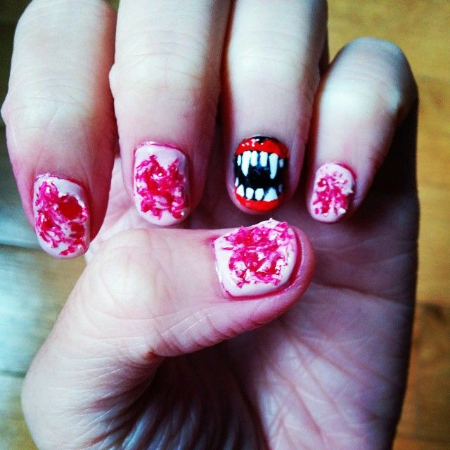 Bloody ripped skin and Vampire teeth Halloween Nails