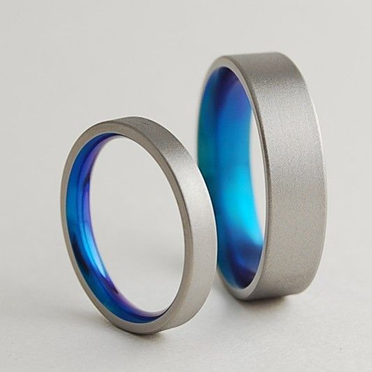 Lovely Titanium Wedding Rings Aphrodite and Apollo Bands by RomasBanaitis I want this in