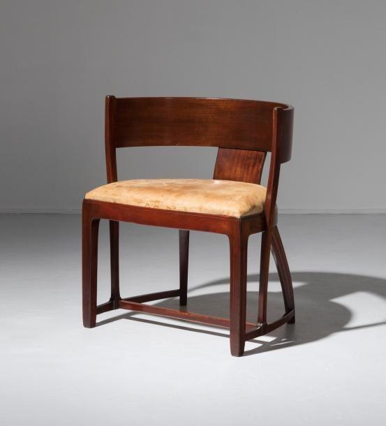 CARL WESTMAN 1866 1936 Su¨de Rare fauteuil Acajou et cuir fauve