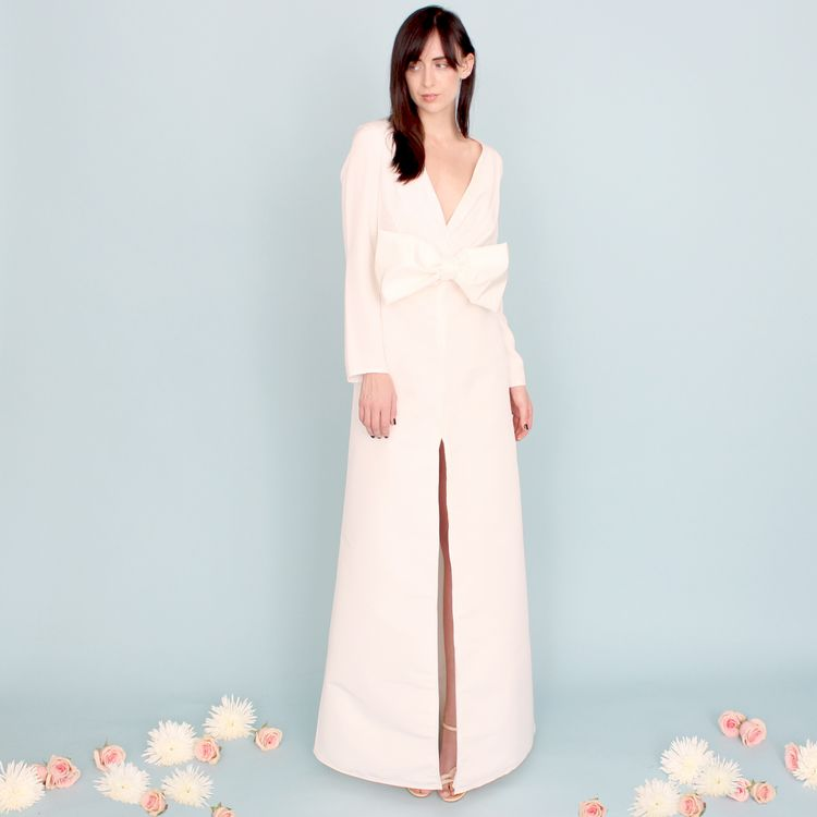 AMANTINE: LONG SLEEVE SILK FAILLE DRESS WITH BOW  Oui! A stunning silk faille dress with deep v-neckline, long sleeves and an oversized bow. Pleated bodice with very thin, tailored shoulder pads.