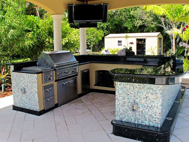 Very Classy Tile And Stainless Steel Covered Patio Kitchen With Bar Type  Top Souround.