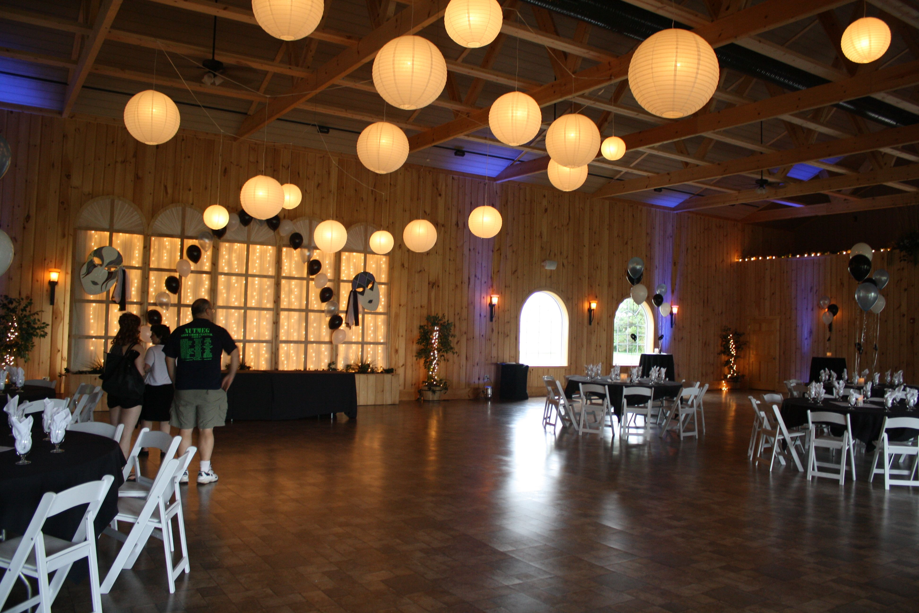 Lanterns Over The Dance Floor At A Masquerade Prom At